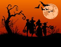 Halloween background. With silhouettes of children trick or treating in Halloween costume Royalty Free Stock Images