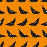 Halloween background with bat pattern. Orange background design with black bats. Halloween theme clean design Royalty Free Stock Photos
