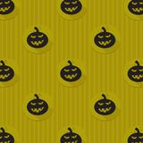 Halloween background with black pumpkins. Green background design with black pumpkin and stripe pattern. Halloween theme clean design Stock Image