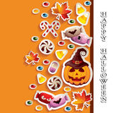 Halloween Background with Candies and Jack O' Lantern Stock Photos