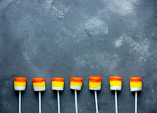 Halloween background - candy corn marshmallow pops border Royalty Free Stock Image