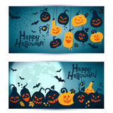 Halloween background of cheerful pumpkins with moon. Royalty Free Stock Photo