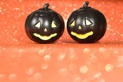 Halloween background concept. Black jack O pumpkin faces on brig. Halloween background decoration holiday concept. Black jack O pumpkin faces on bright glitter stock image