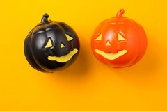 Halloween background concept. Close up of jack O pumpkin faces o. Halloween background decor holiday concept. Close up of jack O pumpkin faces on orange stock photos