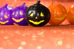 Halloween background concept. Jack O pumpkin faces on bright glitter orange backdrop. Halloween background decoration holiday concept. Jack O pumpkin faces on stock photography