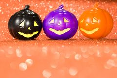 Halloween background concept. Jack O pumpkin faces on bright glitter orange backdrop. Halloween background decoration holiday concept. Jack O pumpkin faces on royalty free stock photo