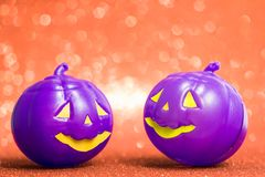 Halloween background concept. Purple jack O pumpkin faces bright. Halloween background decoration holiday concept. Purple jack O pumpkin faces bright colorful royalty free stock photos