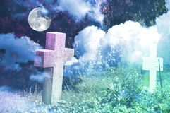Halloween background with crosses nameless, clouds and full moon. Stock Images