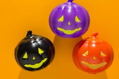 Halloween background concept. Close up of jack O pumpkin faces o. Halloween background decor holiday concept. Close up of jack O pumpkin faces on orange table royalty free stock photography