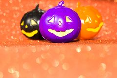 Halloween background concept. Jack O pumpkin faces on bright glitter orange backdrop. Halloween background decor holiday concept. Jack O pumpkin faces on bright stock photo