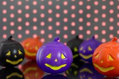 Halloween background concept. Front view of jack O pumpkin faces. Halloween background decoration holiday concept. Front view of jack O pumpkin faces on bright royalty free stock photos