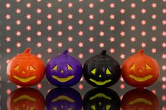 Halloween background concept. Front view of jack O pumpkin faces. Halloween background decoration holiday concept. Front view of jack O pumpkin faces on bright royalty free stock image