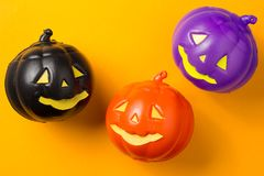Halloween background concept. Top view of jack O pumpkin faces o. Halloween background decoration holiday concept. Top view of jack O pumpkin faces on orange stock photography
