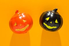 Halloween background concept. Top view of jack O pumpkin faces o. Halloween background decoration holiday concept. Top view of jack O pumpkin faces on orange stock photos