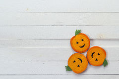Halloween background with decorative pumpkins on white wooden bo Stock Photography