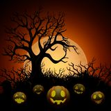 Halloween background with dry tree and pumpkins in graveyard on the moon background Stock Photo