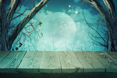 Halloween background with empty wooden table Stock Image