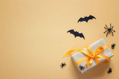 Halloween background with gift box, decorative spiders and bats Royalty Free Stock Image