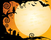 Halloween Background. Gnarled tree with owl, spooky eyes, flying bats and a huge moon – plenty of copy space Royalty Free Stock Photo