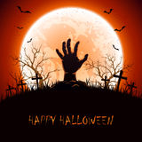 Halloween background with hand on cemetery Stock Image