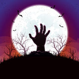 Halloween background with hand and moon Stock Photo
