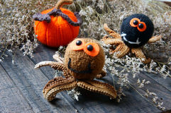 Halloween background, handmade, pumpkin, spider, october. Halloween background with handmade pumpkin, funny spider, with knitted decoration for holiday seasonal Royalty Free Stock Photos