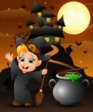 Halloween background with happy boy witch holding broomstick and cauldron Royalty Free Stock Photos