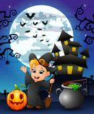 Halloween background with happy boy witch holding broomstick pumpkin and cauldron Royalty Free Stock Photos