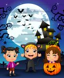 Halloween background with happy girl wearing costume cat, little girl and girl smiling in basket pumpkin Royalty Free Stock Photo