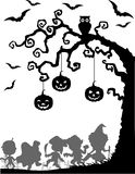 Halloween background with happy kids silhouette wearing Halloween costume Royalty Free Stock Images