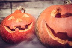 Halloween background with Jack O lanterns in mist Stock Photos