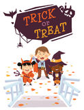 Halloween background with kids in Halloween costumes. Trick or Treat Royalty Free Stock Photography