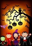 Halloween background with little kids wearing Halloween costume Stock Photos