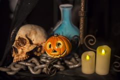 Halloween background with a lot of different witchcraft tools: s. Still Life of skull  and candle in dim light night Stock Photography