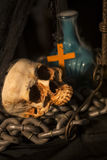 Halloween background with a lot of different witchcraft tools: s. Still Life of skull  and candle in dim light night Royalty Free Stock Photography