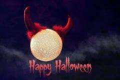 Halloween background moon devil horns on dark Stock Photos