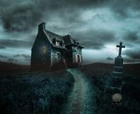 Halloween background with old house. Apocalyptic Halloween scenery with old house, skull and grave stock images