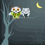 Halloween background with owls on the dead tree Stock Photos