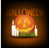 Halloween background with pumpkin with candles and grass Royalty Free Stock Images