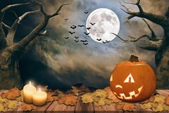 Halloween background with pumpkin and full moon Stock Images