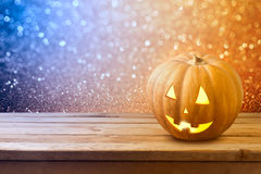 Halloween background with pumpkin jack lantern on wooden table Stock Photo
