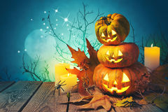 Halloween background with pumpkin jack o lantern on wooden table Stock Photography