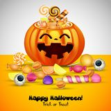 Halloween background with pumpkins basket and candies Royalty Free Stock Photos