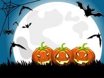 Halloween background pumpkins big moon Stock Photos