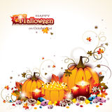Halloween Background with Pumpkins. Candles and basket full of candies Stock Photography