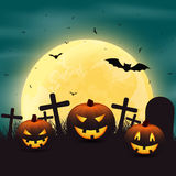 Halloween background with pumpkins in the graveyard. Royalty Free Stock Images