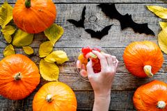 Halloween background. Pumpkins, paper bats and autumn leaves on wooden background top view.  Royalty Free Stock Photography