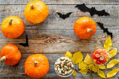 Halloween background. Pumpkins, paper bats and autumn leaves on wooden background top view copyspace. Halloween background. Pumpkins, paper bats and autumn Royalty Free Stock Photography