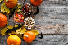 Halloween background. Pumpkins, paper bats and autumn leaves on wooden background top view copyspace. Halloween background. Pumpkins, paper bats and autumn Royalty Free Stock Photo
