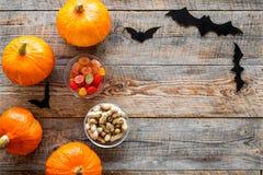 Halloween background. Pumpkins and paper bats on wooden background top view copyspace. Halloween background. Pumpkins and paper bats on wooden background top Stock Image